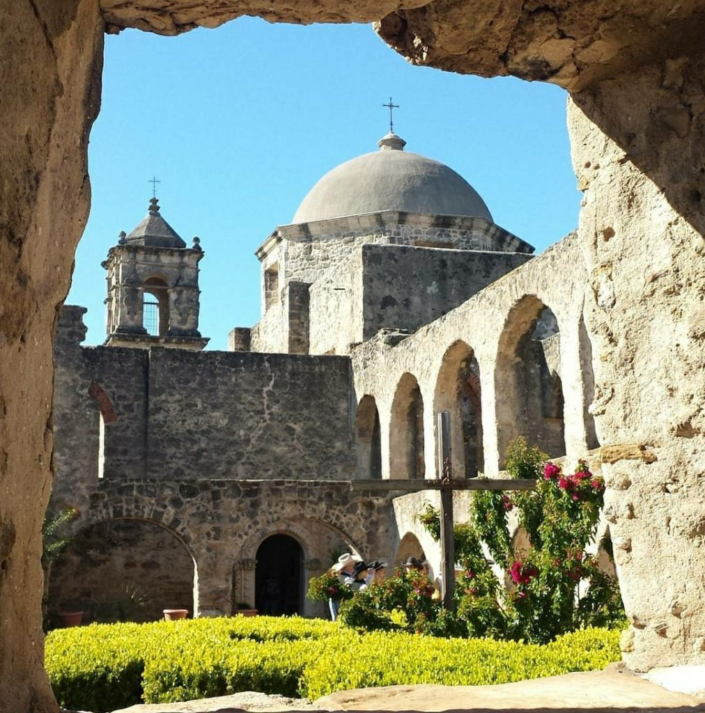 Mission in San Antonio Texas as seen through a limestone opening in the wall