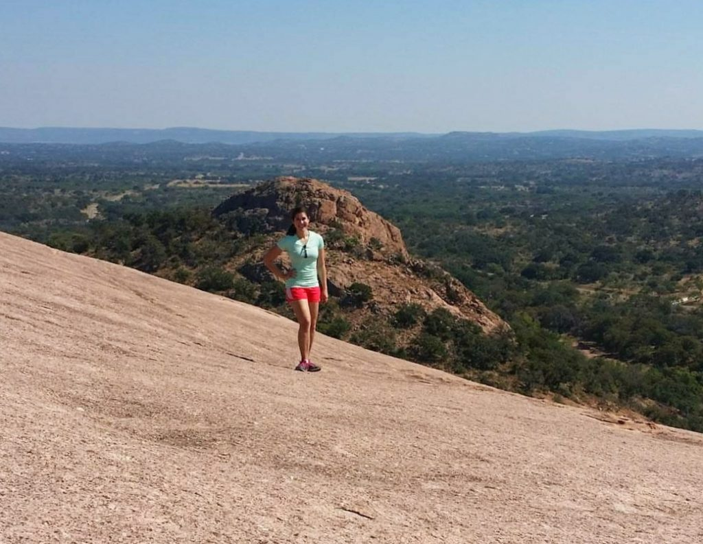 Kate Storm hiking on Enchanted Rock State Natural Area on a day trip from Austin