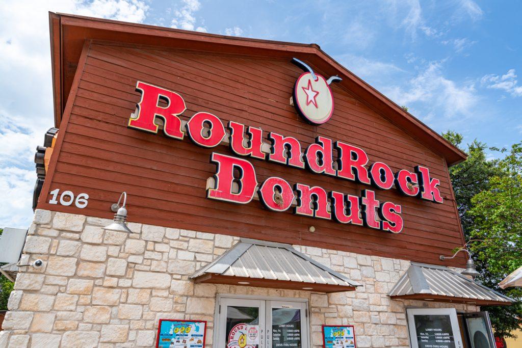 Exterior of Round Rock Donuts as seen from the corner, one of the best things to see in Texas for foodies