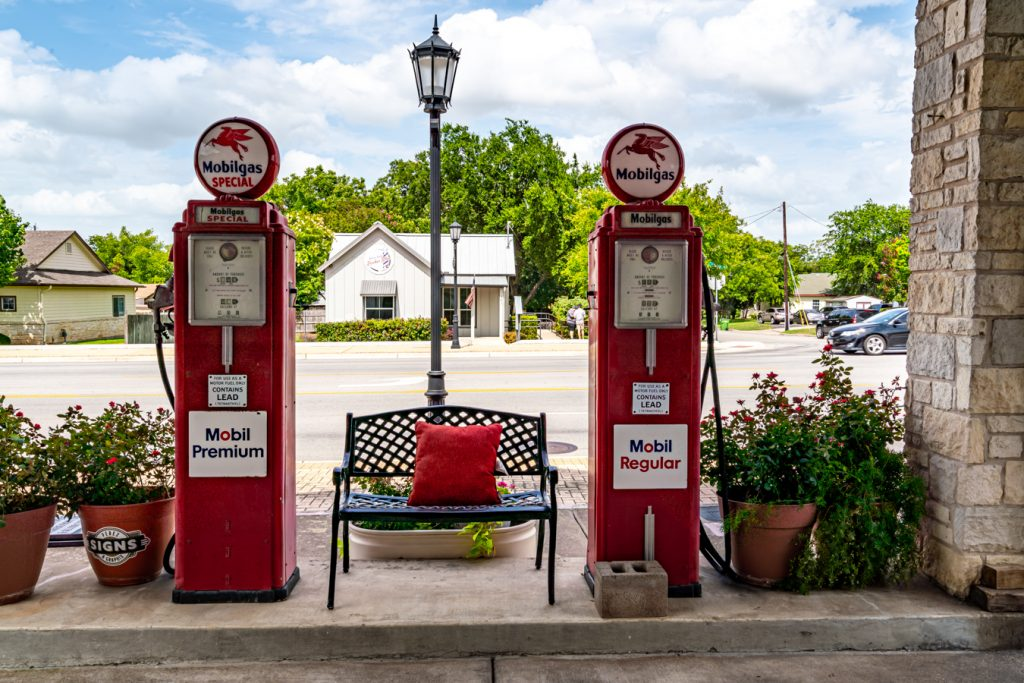 2 vintage red gas pumps in round rock texas