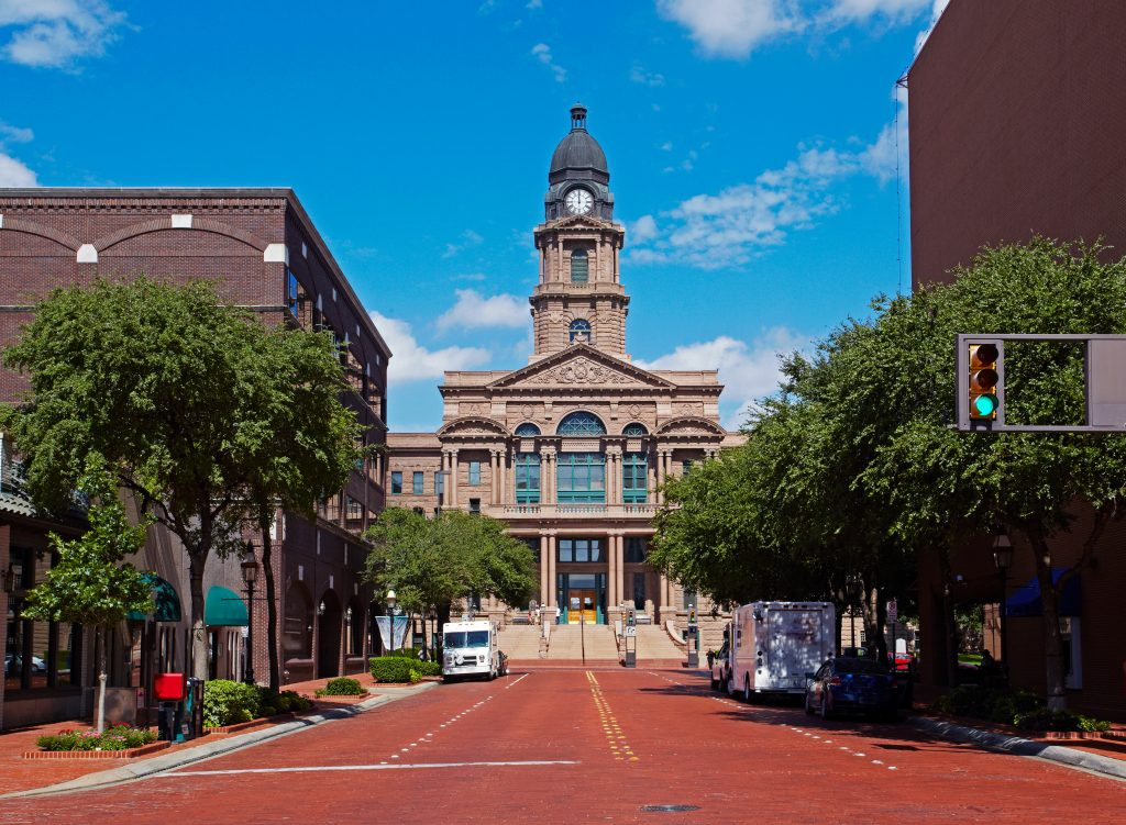 Tarrant County Court as seen from the end of a red brick street