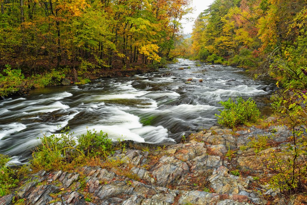 flowing river in Beaver Bend State Park near Broken Bow Oklahoma surrounded by fall foliage