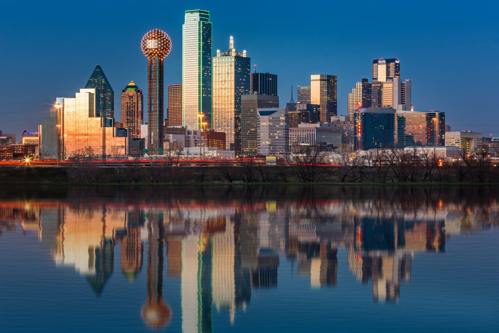 Dallas skyline at night with Reunion Tower visible on the left side of the photo. Reunion Tower is one of the most instagrammable places in Dallas!
