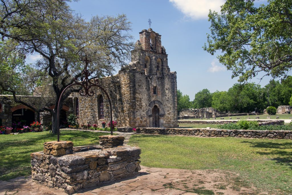 Mission Espada in San Antonio Texas photographed from an angle with the front of the church visible