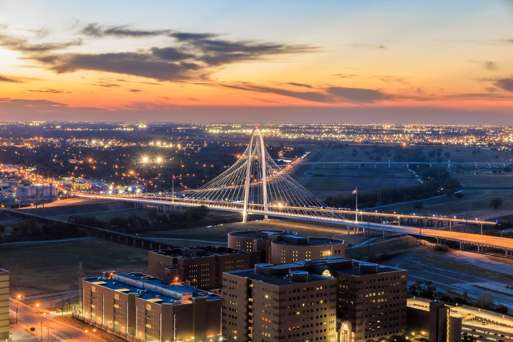 Margaret Hunt Hill Bridge in Dallas Texas as seen from above at sunset. This bridge is one of the most instagrammable places in Dallas Texas!