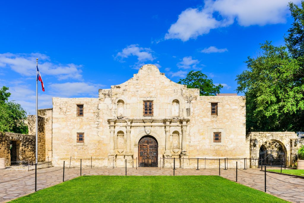 Front facade of the Alamo on a sunny day, one of the best things to see during a long weekend in San Antonio TX