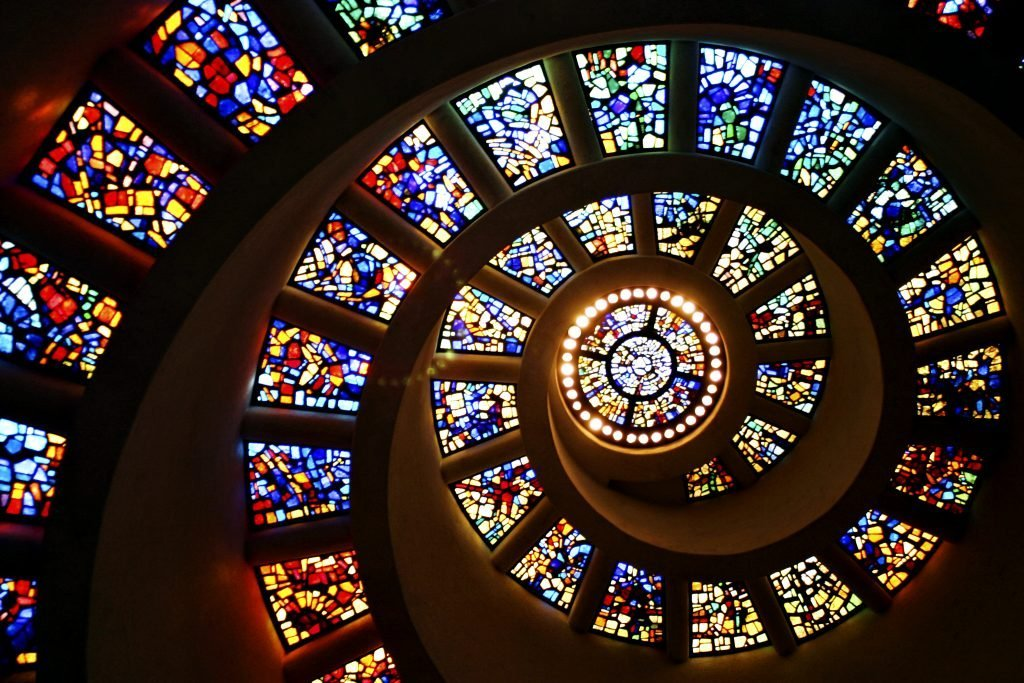 Spiral stained glass staircase in Thanksgiving Chapel, one of the best Dallas photography spots