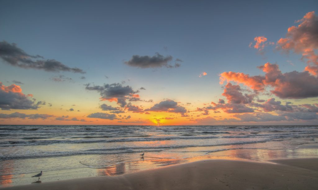 Sunrise over the beach in South Padre Island Texas, one of the best Texas romantic getaways
