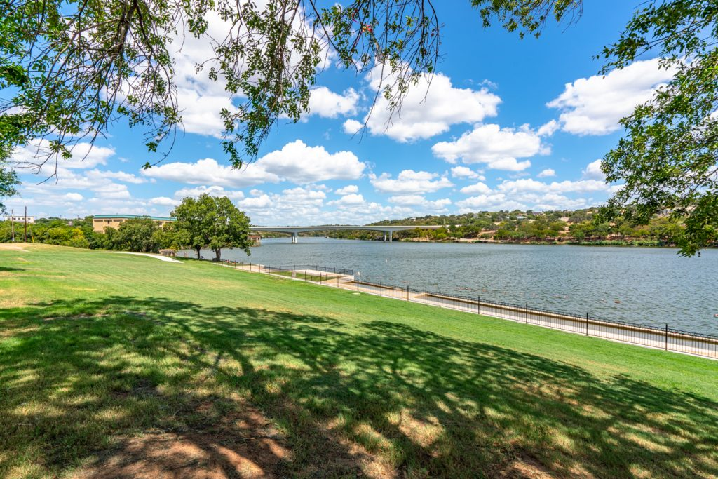 Lake Marble Falls in Texas with a green lawn in the foreground