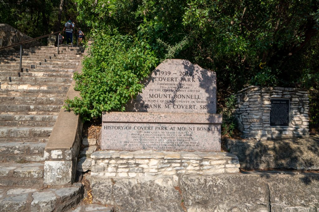 Sign for Covert Park at Mt Bonnell with the staircase visible to the left side of the photo