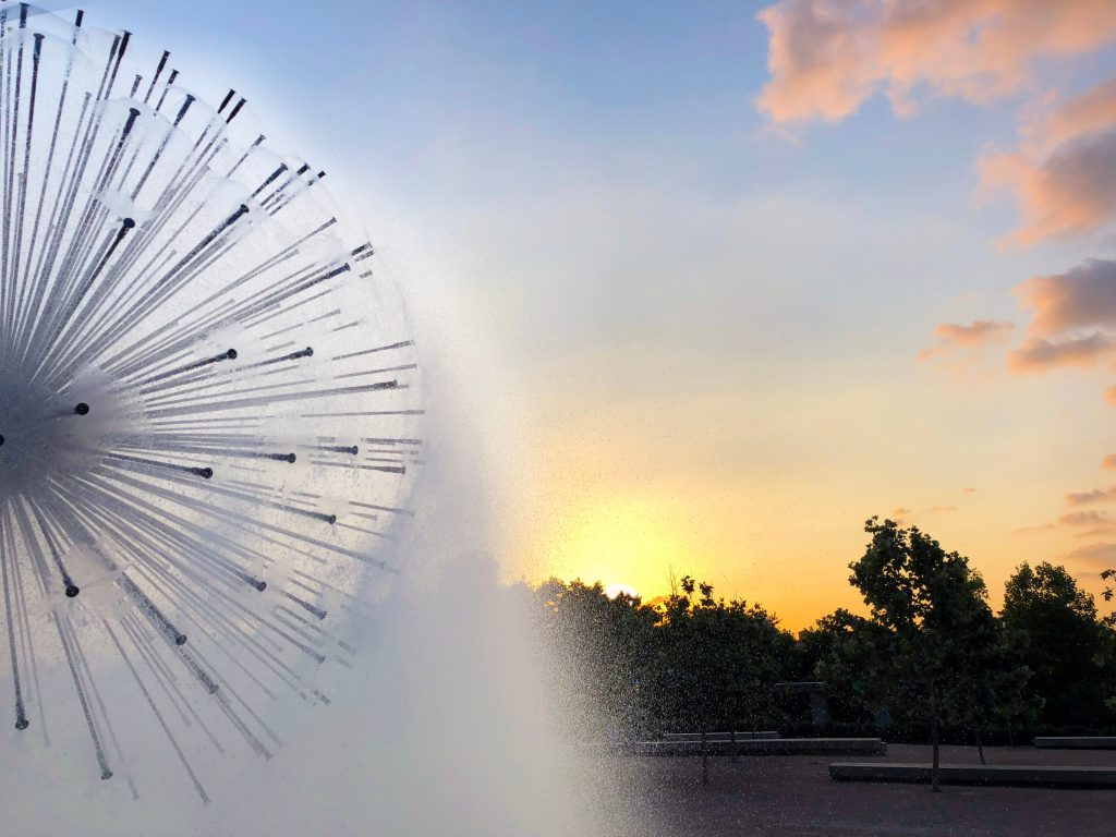 One half of Houston's dandelion fountain at sunset, one of the most instagrammable places in houston texas