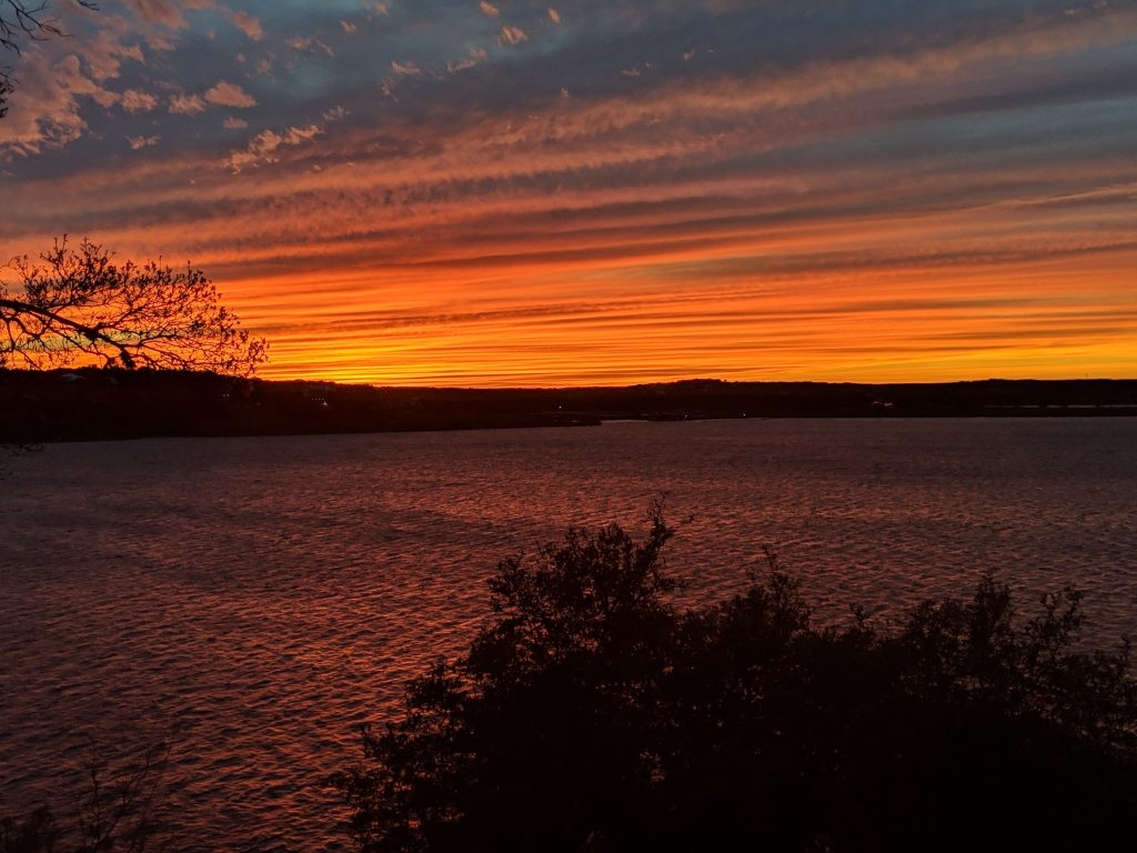 Bright orange sunset over Canyon Lake TX. Sunsets are a fabulous idea of what to do in Canyon Lake TX
