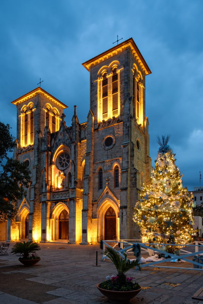 San Fernando Cathedral in San Antonio during the holidays with a Christmas tree out front