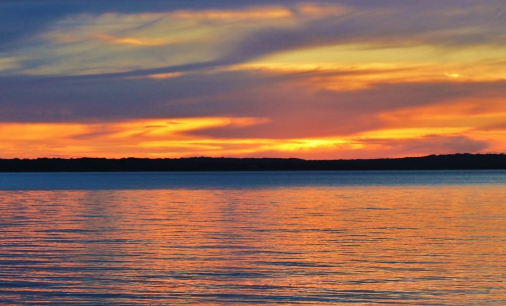 Sunset over Lake Texoma, one of the best dallas weekend getaway ideas