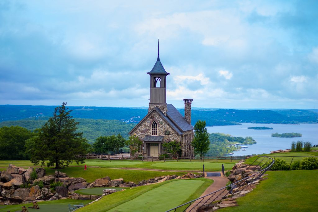 Chapel of the Ozarks in Branson Missouri as seen from above with lake visible in the background