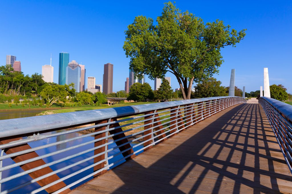 Bridge at Memorial Park in Houston with skyline in the background. Memorial Park is home to great hiking trails in Houston TX