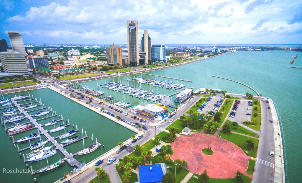 Corpus Christi from above with the harbor in the foreground and the skyline in the background