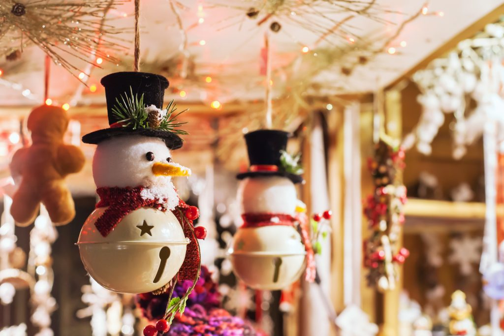 Crafted snowmen ornaments for sale at a Christmas market
