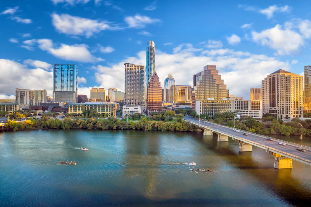 Skyline of Austin Texas as seen over Lady Bird Lake. Austin is one of the best weekend getaways from Dallas tx