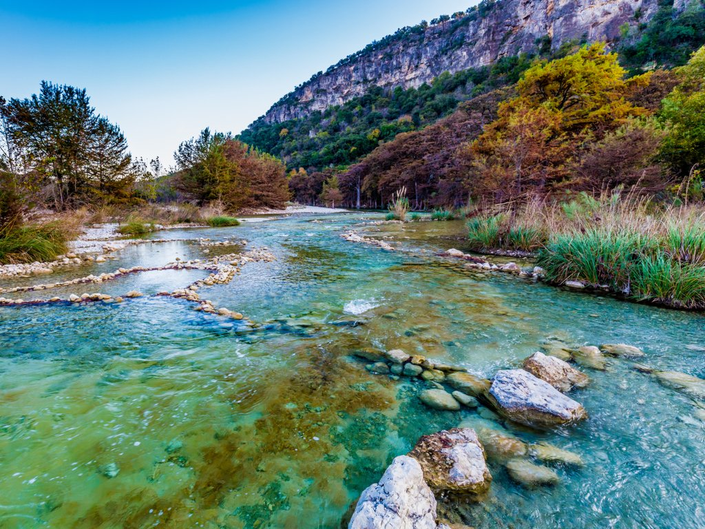 View of the turquoise water of the Frio River in Garner State Park, one of the best weekend getaways from Austin TX