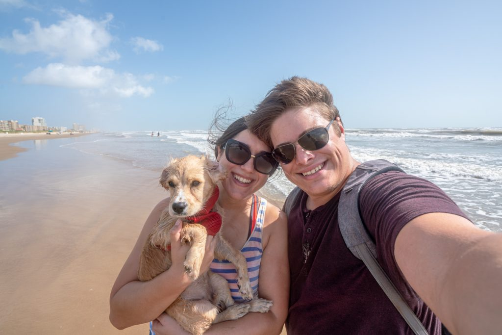 Kate Storm Jeremy Storm and puppy Ranger taking a selfie on the beach in South Padre Texas