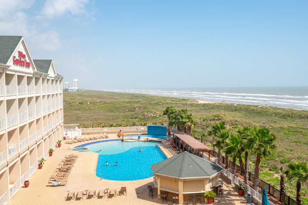 View of the pool at the Hilton Garden Inn in South Padre Island from above
