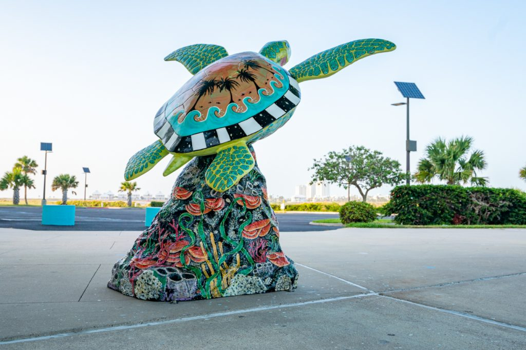 Colorful statute of a sea turtle near the SPI Convention Center. Snapping photos nearby is one of the best things to do on South Padre Island TX