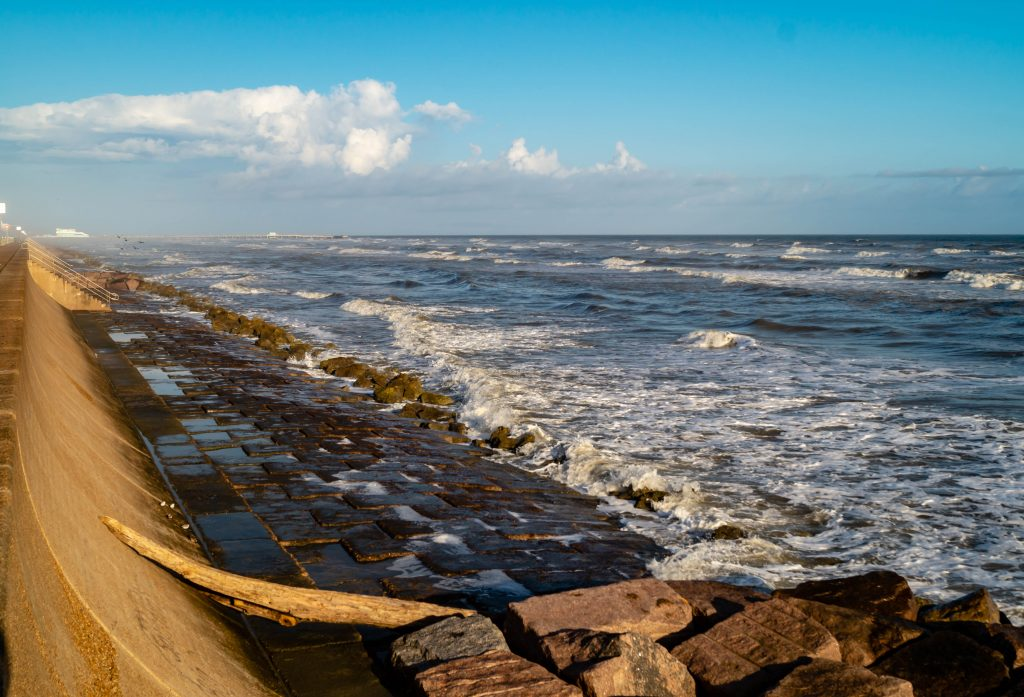 view along the seawall. when deciding what to do in galveston tx, consider riding bikes along the seawall