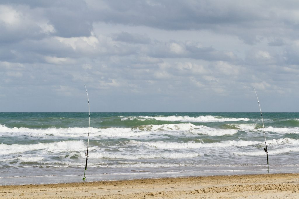 Two fishing rods set up on the South Padre beach