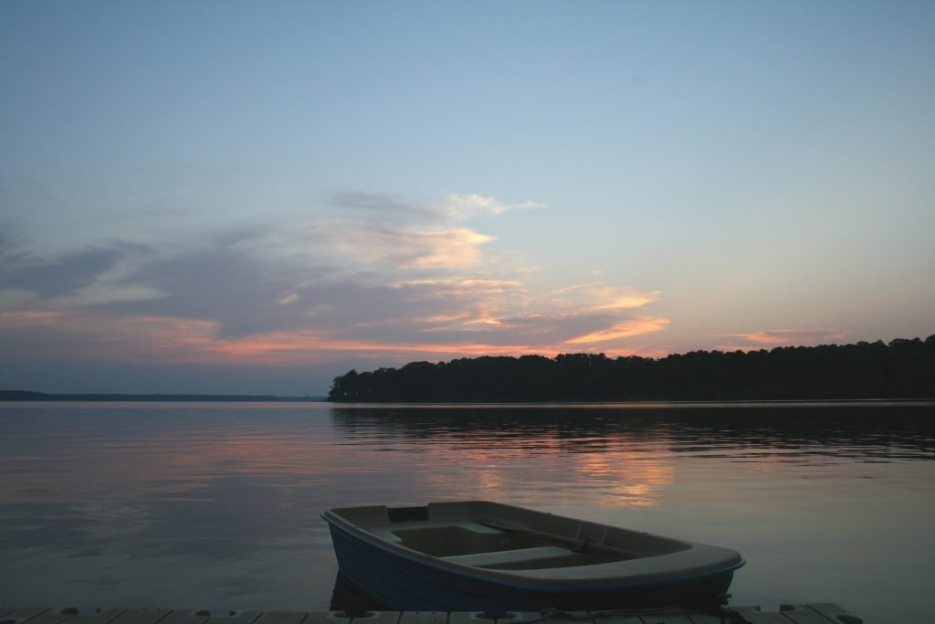 Sunset on Lake O'the Pines in Texas with a small rowboat visible in the foreground
