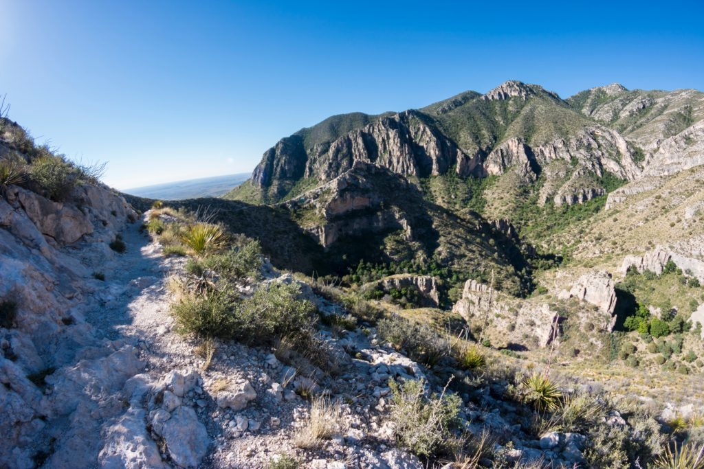 Rocky hiking trail with mountains in the distance in Guadalupe Mountains National Park, home to some of the best hiking in Texas