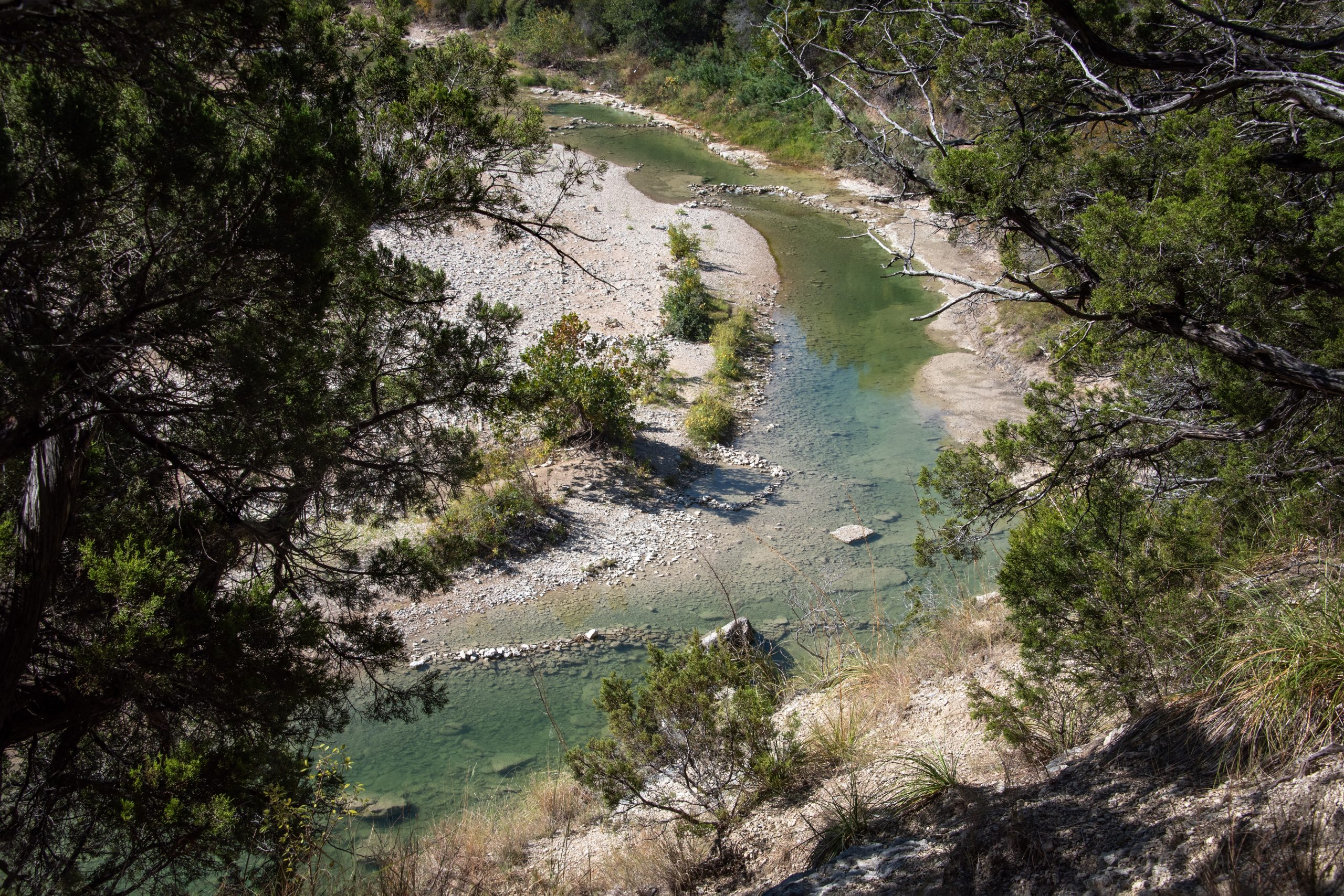 Curving Paluxy River as seen from above in Dinosaur Valley State Park, home to some of the best camping near dallas texas