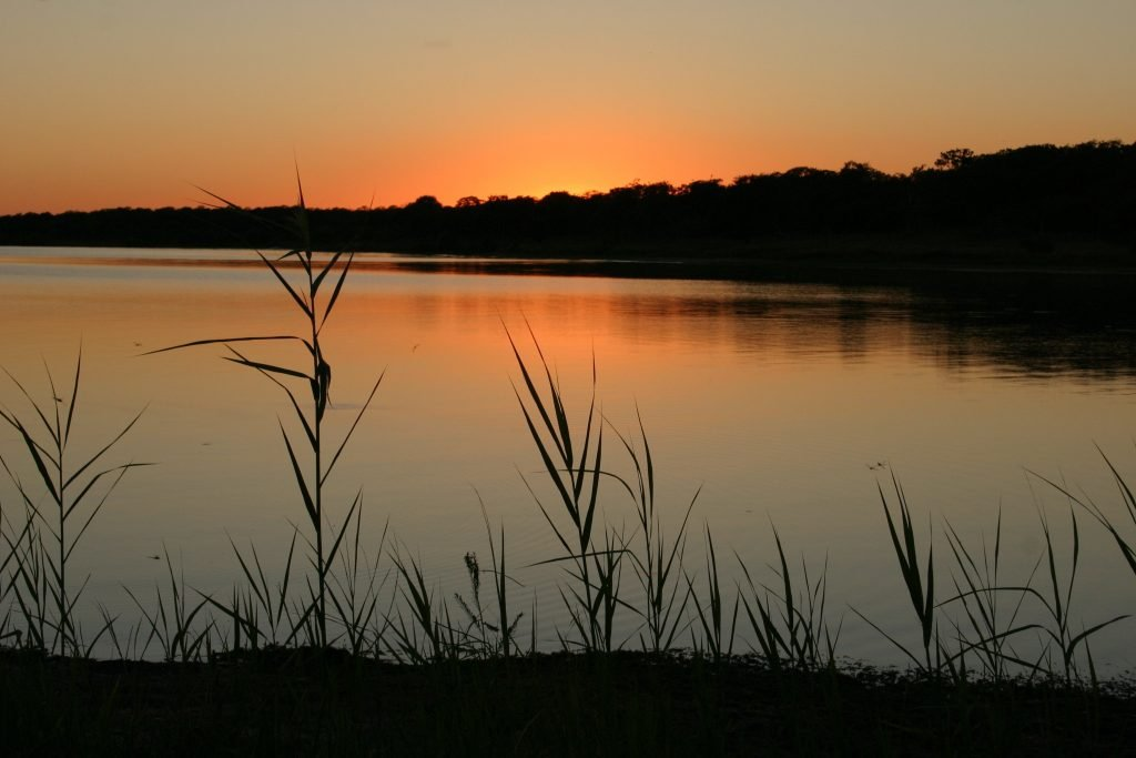 Orange sunset on Lake Somerville Texas as seen from shore