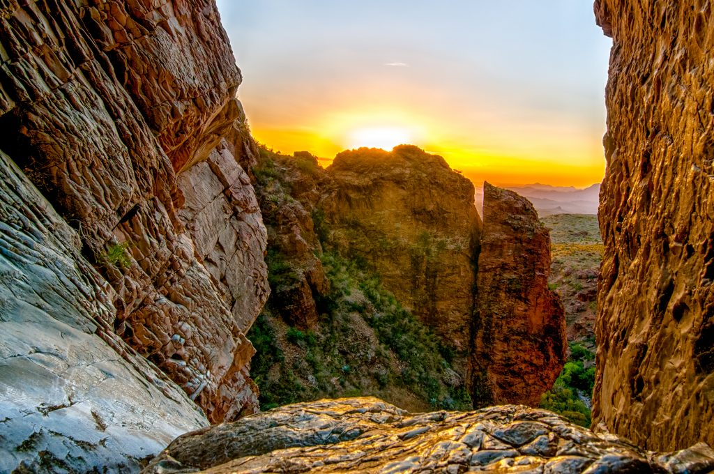 sunset over a rocky section of texas hiking trail in big bend nap, home to some of the best hiking in texas