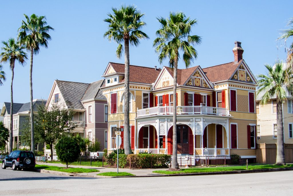 Yellow house situated on a corner in the East End Historic District. Strolling by these Victorian homes is one of the best things to do in Galveston TX