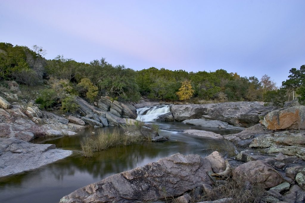 devils waterhle at inks lake state park texas near sunset