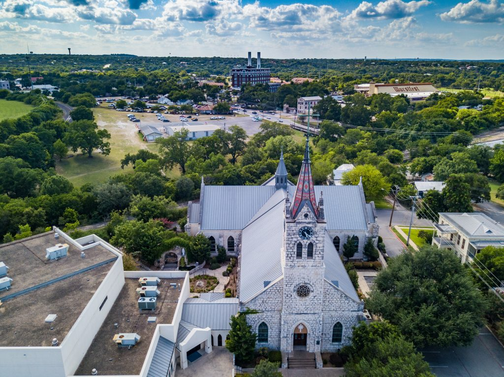 German style church in New Braunfels Texas as seen from above, one of the best places to visit when driving from San Antonio to Austin