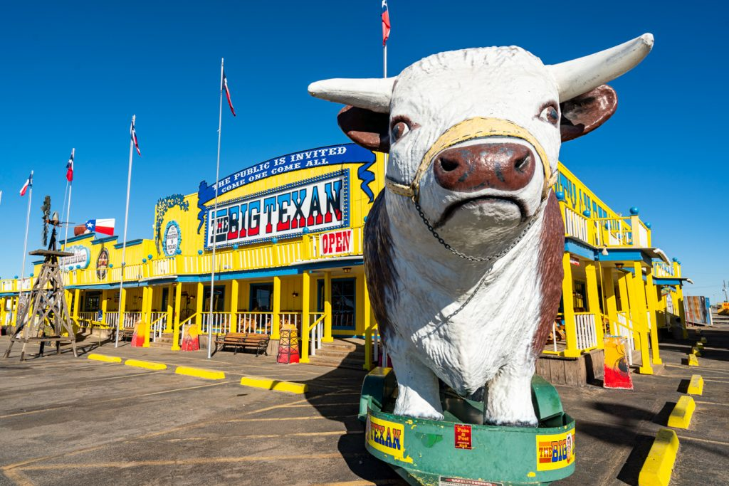 Cow statue in front of Big Texan Steak Ranch, one of the most iconic roadside attractions on Route 66 Texas