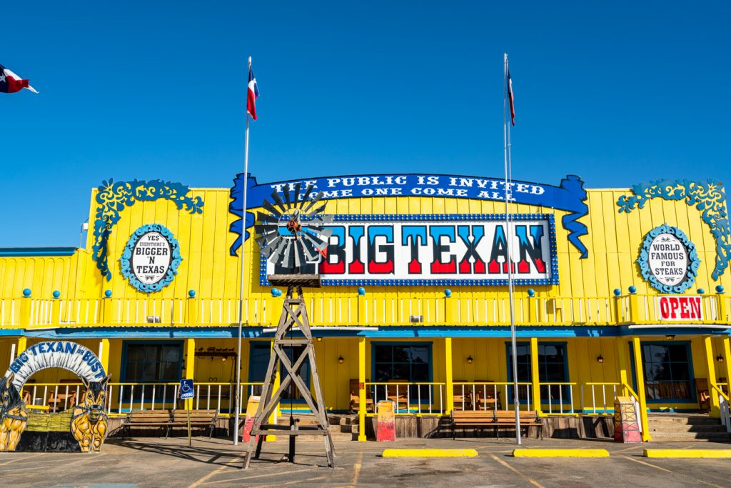 Yellow building of Big Texan State Ranch shot from the front, one of the best texas route 66 attractions