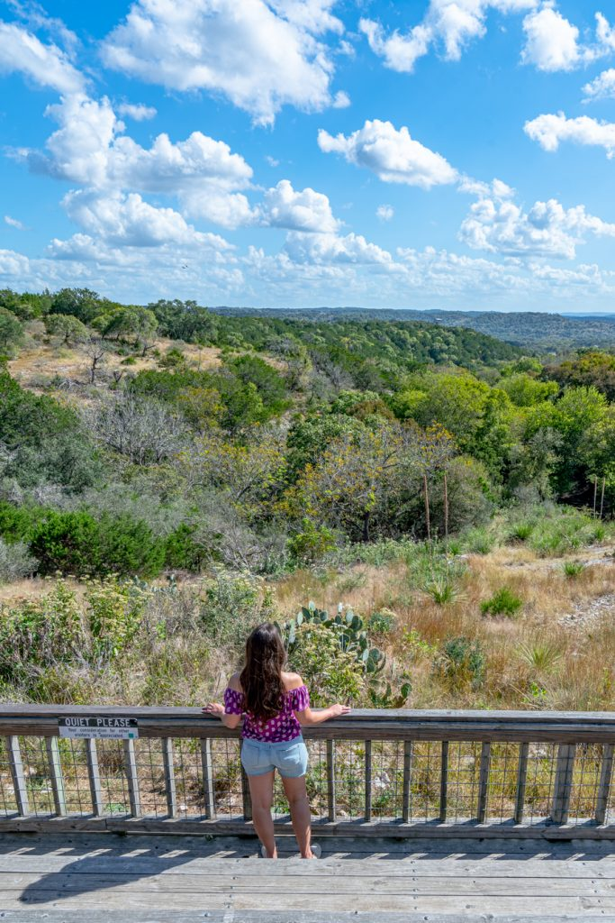 Kate Storm standing at the upper viewing platform at old tunnel state park texas