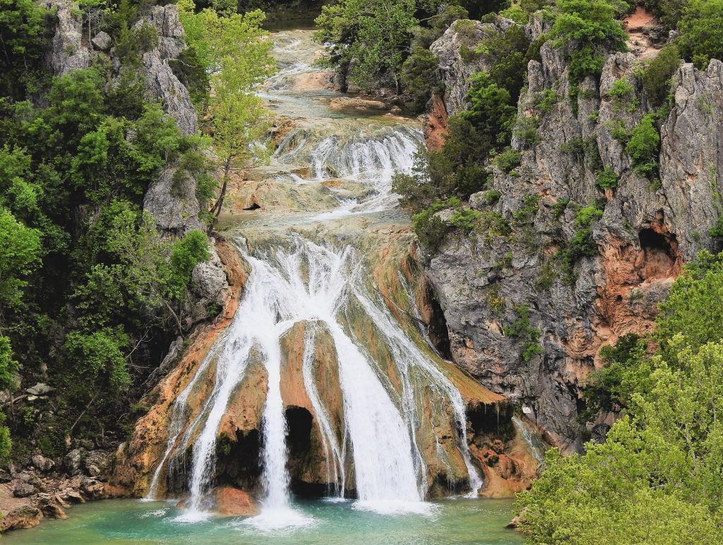close up of turner falls in davis oklahoma, one of the best road trips from san antonio texas