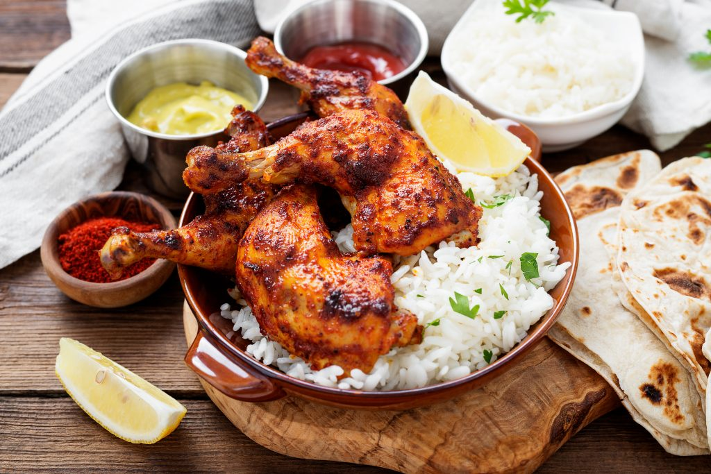 tandoori chicken served over rice, one of the best indian foods to try in dallas