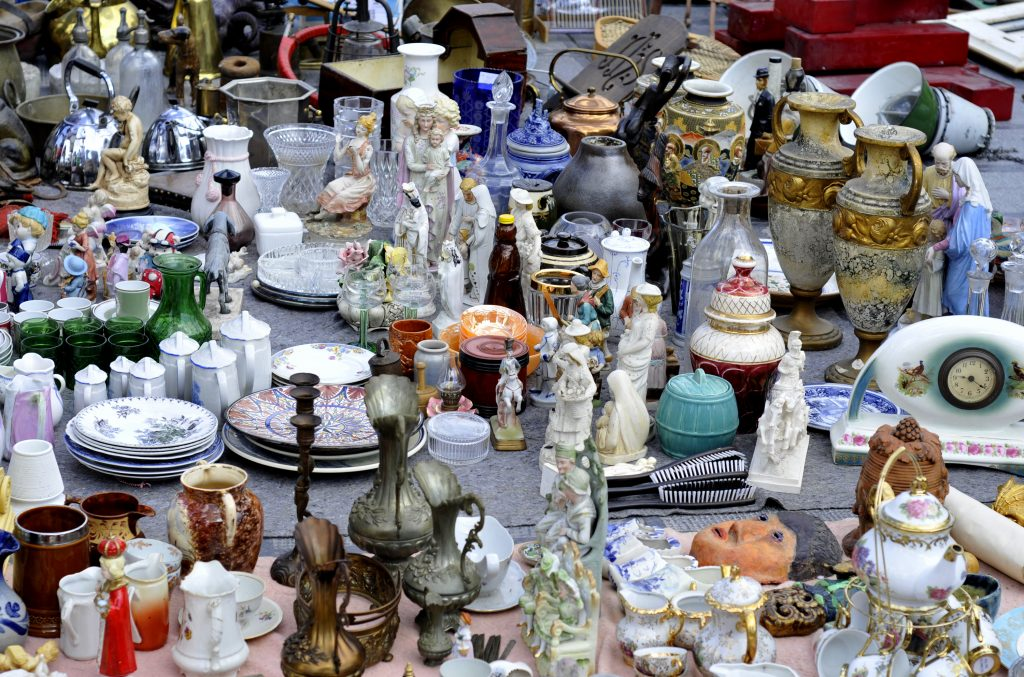 Collection of small porcelain items for sale at a flea market. First Monday Canton is one of the most interesting things to do in Texas for people interested in flea markets!