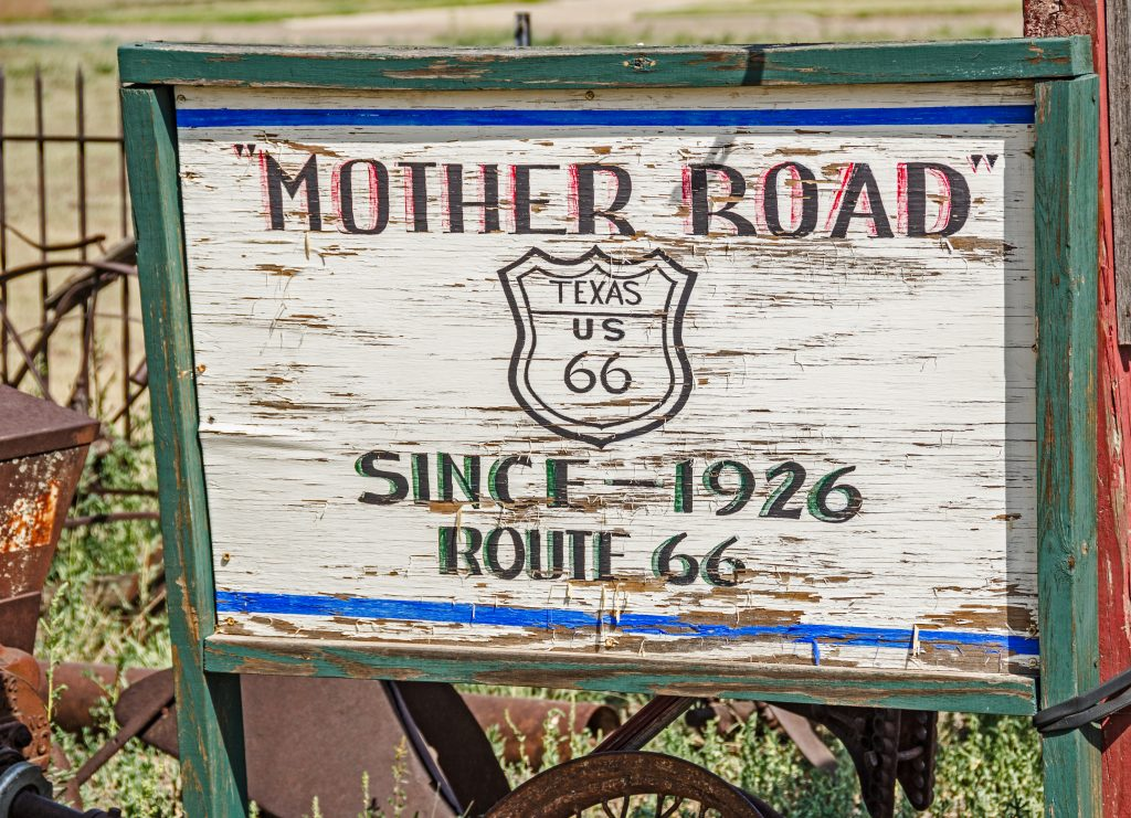 "disheveled sign reading ""mother road since 1926"""
