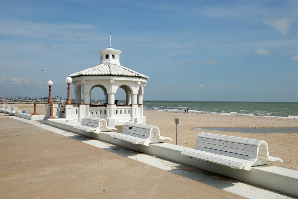 beach in corpus christi texas with a small white gazebo along the promenade