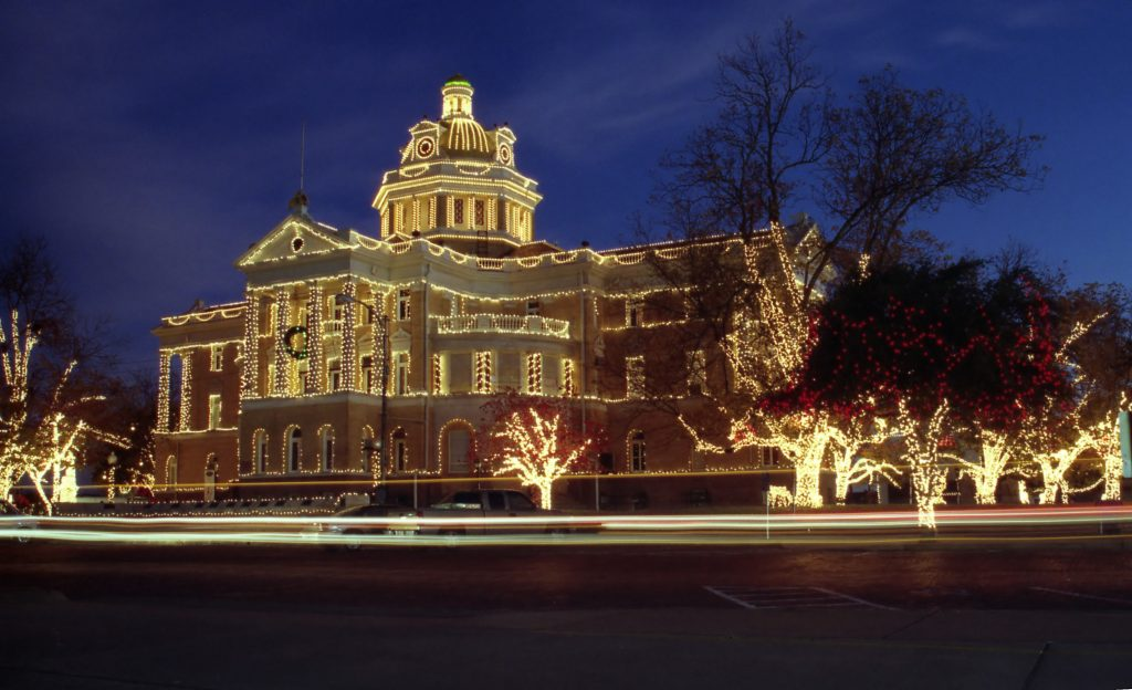 County courthouse in Marshall, one of the best Christmas towns in Texas, lit up with holiday lights