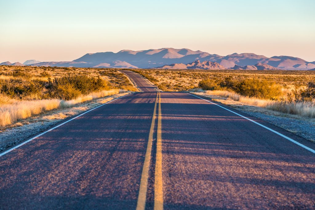 open road in west texas near sunset. some of the best weekend getaways from san antonio tx are in west tx