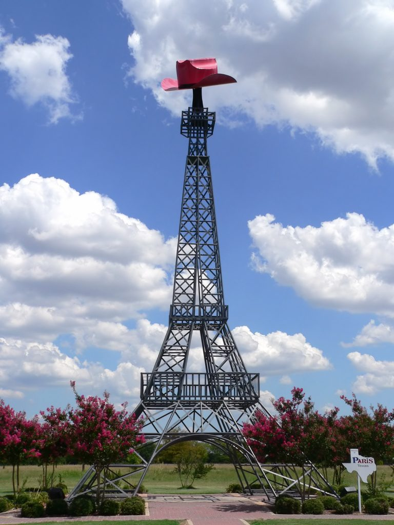 Eiffel Tower in Paris Texas with a red cowboy hat on top, belongs on any list of what to do in Texas