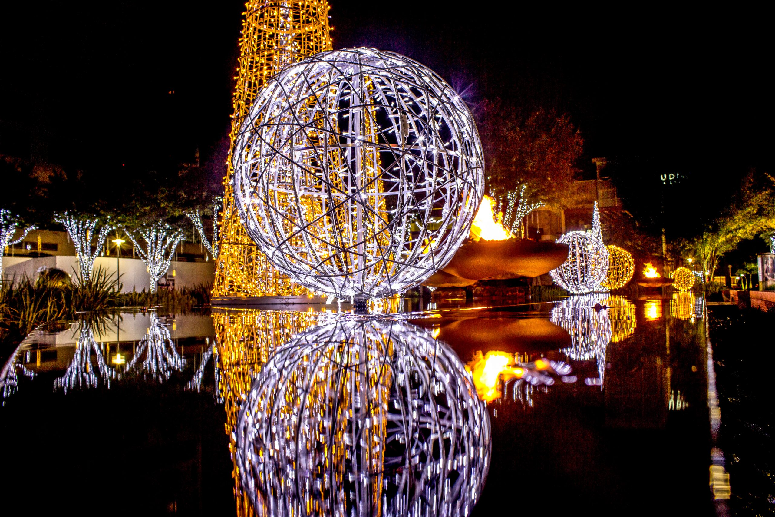 Christmas light display with a giant orb--you'll find impressive displays like this all over the best places to celebrate Christmas in Texas
