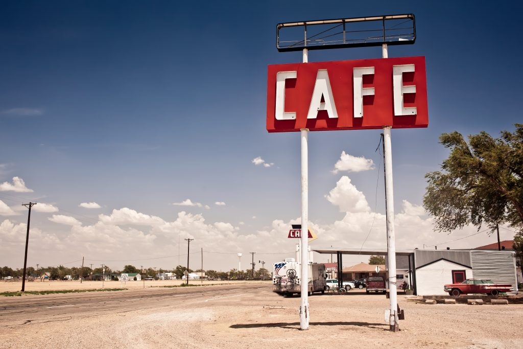 red sign for the midpoint cafe, one of the most famous texas route 66 attractions